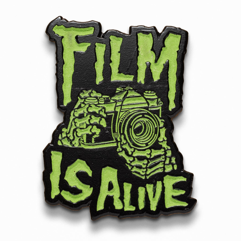 Film is Alive Glow in the Dark Lapel Pin
