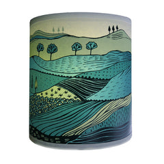 Lush designs Small lampshade with a print of a landscape of rolling hills in beautiful greens