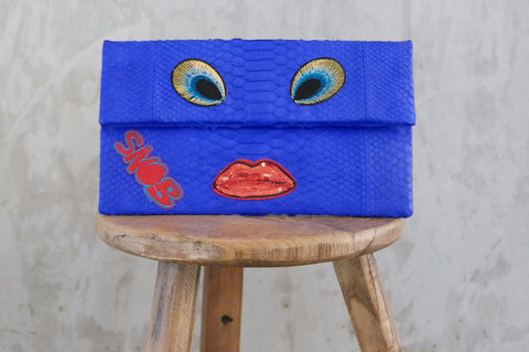 Blue Eyes Leon Small Patched Clutch customized by Suzette Creative Team