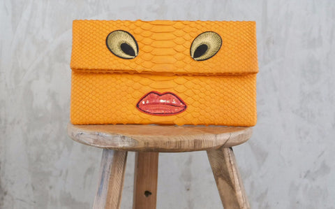 Orange Eyes Leon Small Patched Clutch customized by Suzette Creative Team
