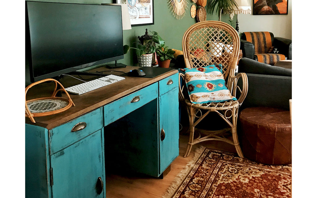 Eclectic boho apartment. Renovated vintage desk and rattan chair | House Tour on The Inkabilly Blog