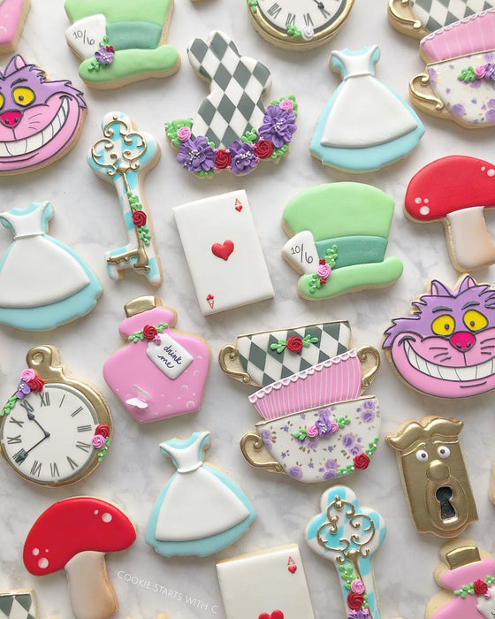 """Were All Mad Here"" Alice In Wonderland Iced Sugar Cookies featured on TheIcedSugarCookie.com created by @cookiestartswithc #aliceinwonderlandcookies #aliceinwonderlandsugarcookies #aliceinwonderland #cookies #sugarcookies #decoratedcookies"