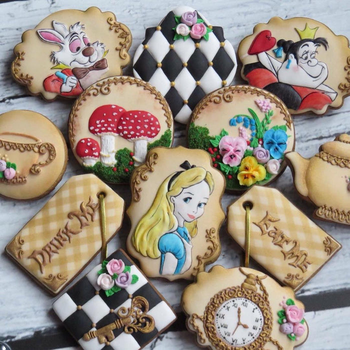 Alice In Wonderland Iced Sugar Cookies featured on TheIcedSugarCookie.com Created by @maybeacookie #cookies #sugarcookies #aliceinwonderlandcookies #theicedsugarcookie