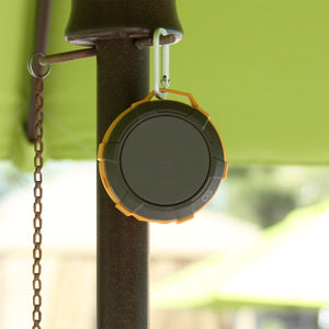 Omnigates Aeon Bluetooth Speaker POD clipped on patio umbrella