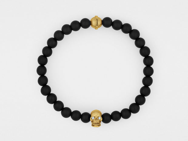 Skull Bracelet in 18K Gold with Diamond Eyes and Black Onyx