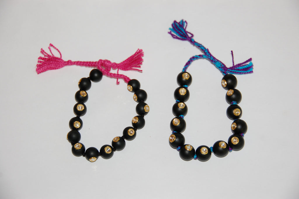 Mat black onyx bead with 15 Polki diamonds bracelet