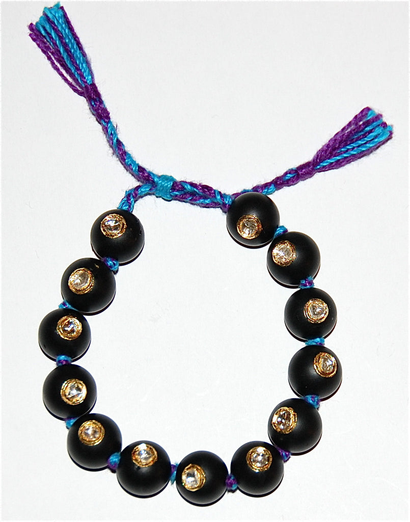 Mat Black Onyx bead with 13 polki diamonds bracelet
