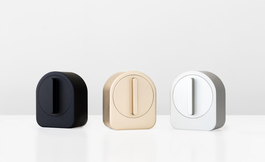 A collection of 3 Sesame devices in black, gold and white