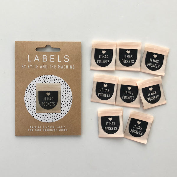 'It Has Pockets' woven labels