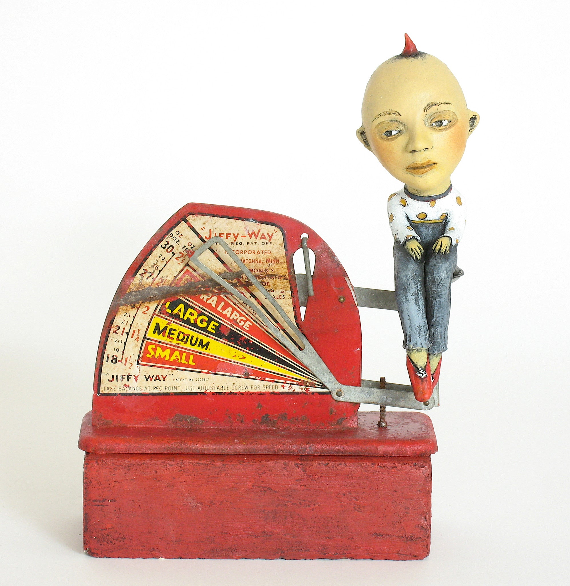 "SOLD   ""Egg-Headed Boy Weighs In""    original ceramic sculpture with antique egg scale by Jacquline Hurlbert"