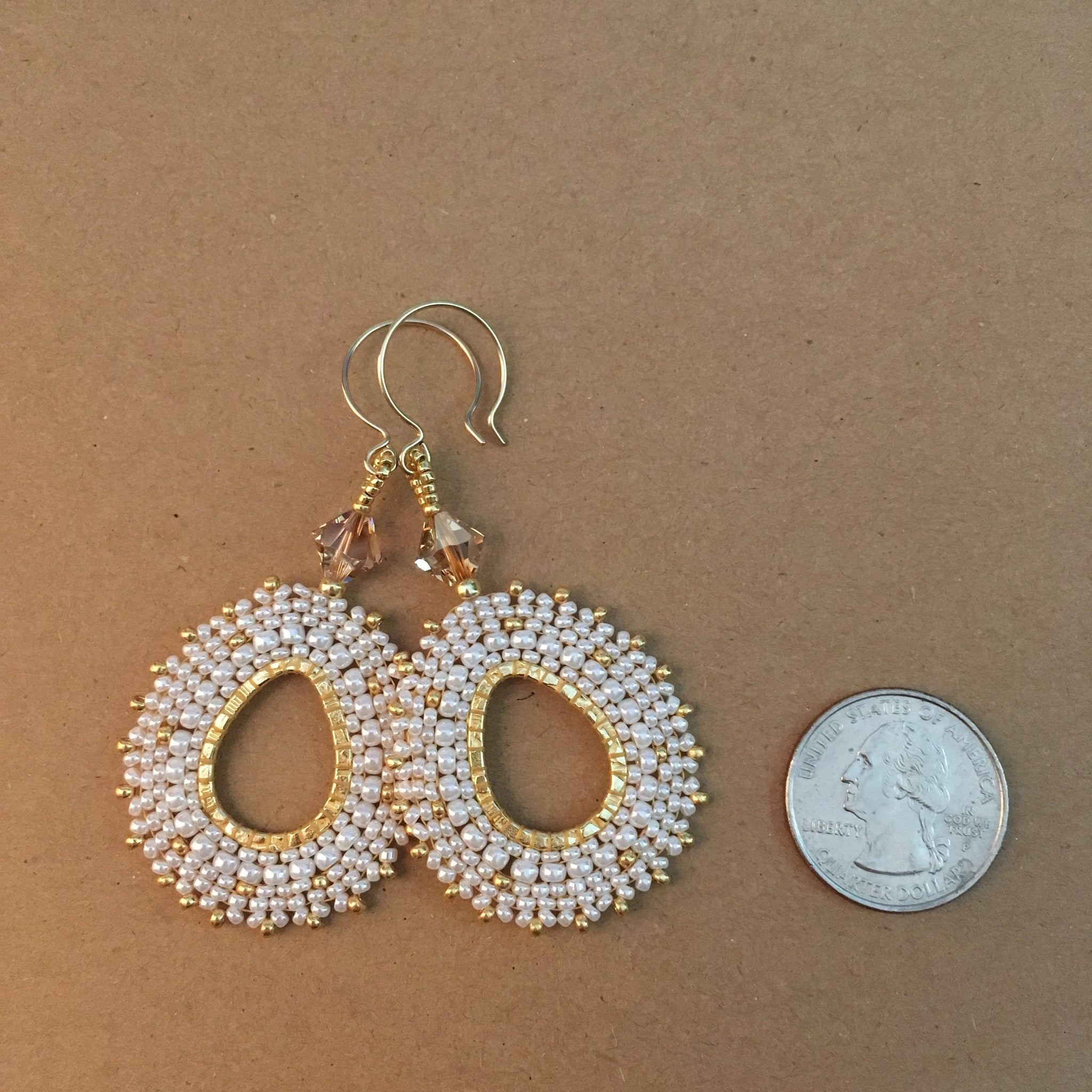 Pearly White and Gold Oval Hoop Earrings