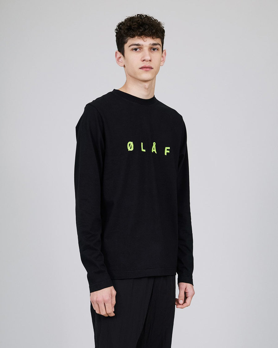 ØLÅF Sans LS Black, Portuguese fabric, 100% cotton (220 grams/sqm), Post wash, Chain stitch logo on the front, Fine ribbed collar, Made in Portugal