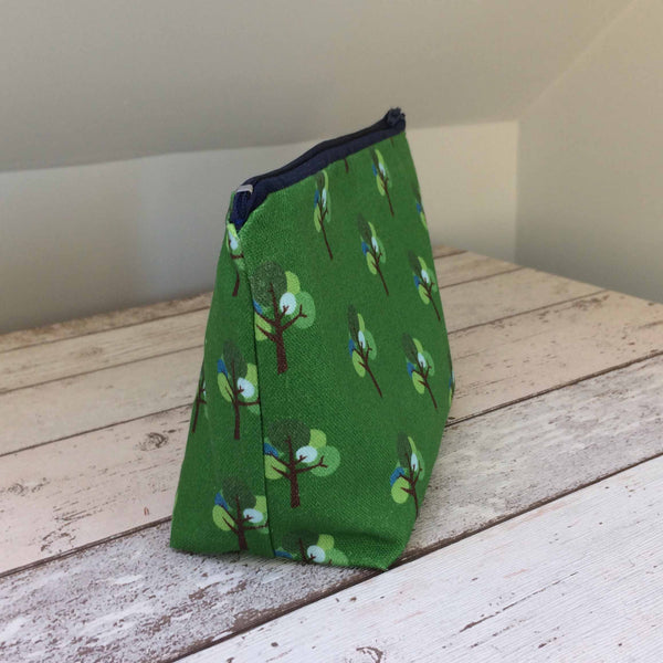 Make up cosmetics bag by Tiny Bird Textiles Oak Tree repeat pattern in green and blue on dark wood dressing