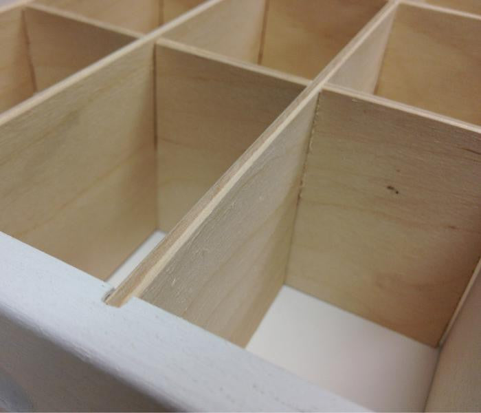 A close up of the wooden inserts where the journaling cards go.