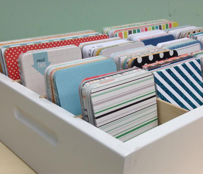 A close up of the front corner of the organizer. The side handles are shown.