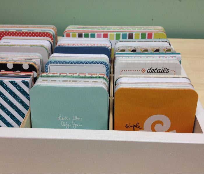A straight ahead view of the journaling cards organized in the cubby.