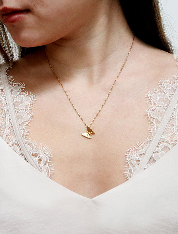 gold butterfly necklace worn