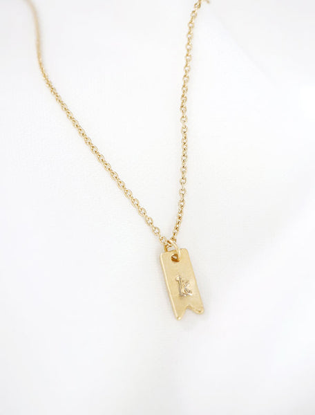 gold initial ribbon tag necklace