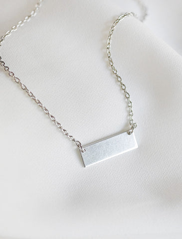 tiny ribbon tag necklace