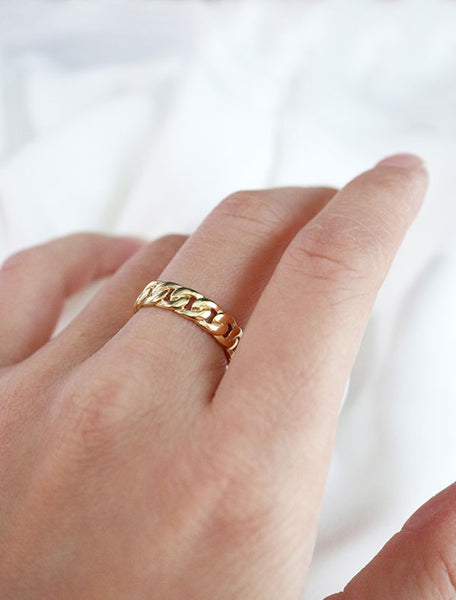 gold chain link ring worn