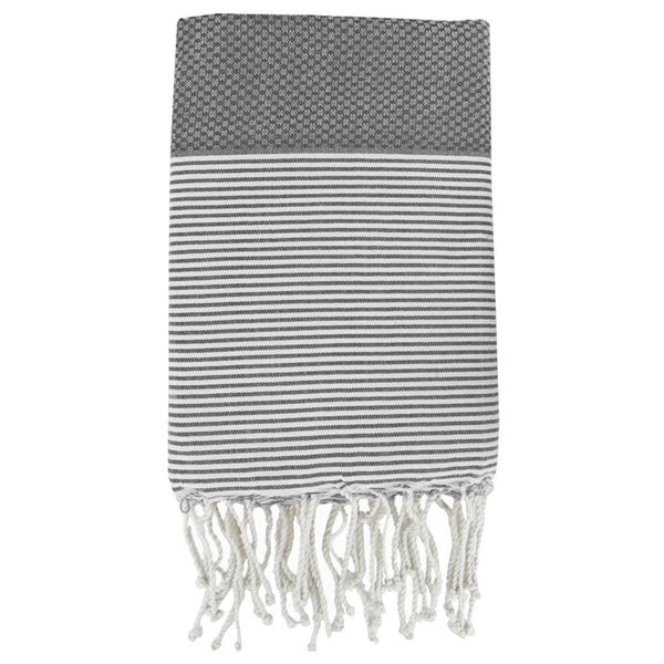 Folded cotton hammam towel with honeycomb weave in mid-grey colour with grey/white stripe detail and tassel ends