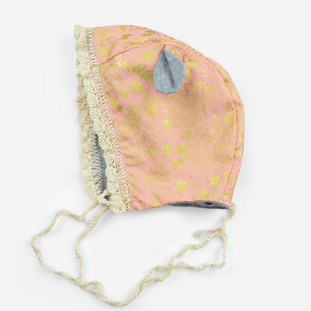 reversible cotton bonnet for babies in chambray and crochet trim and ears with pink and gold floral print fabric