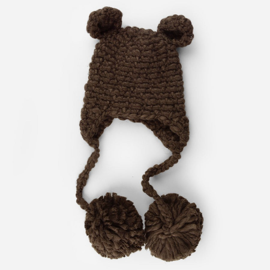 crochet bear hat with ears and pom tassels for baby and toddler cream