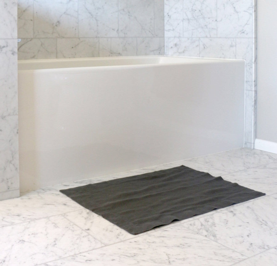 bathtub with 100% linen bath mat heavyweight Orkney linen fabric absorbent anti-microbial fast drying black color