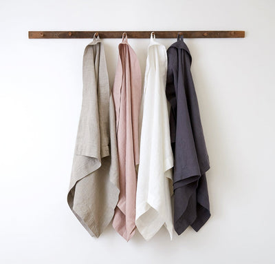 hanging set of 100% linen bath sheets heavyweight Orkney linen fabric sturdy antimicrobial large bath towels natural light beige tan rose light pink off-white white charcoal dark grey colors