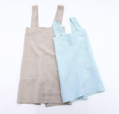 picture of child and woman wearing 100% linen pinafore apron natural beige tan light blue aqua colors