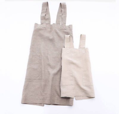 picture of child and woman wearing 100% linen pinafore apron natural beige tan off-white colors