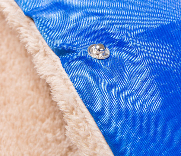 close up of a square memory foam blue dog bed with plush cover and reflective tyker logo