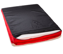 back of a square memory foam red dog bed with plush cover and reflective tyker logo