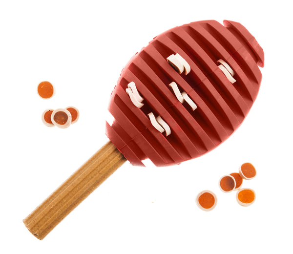brown rubber rugby shaped treat dispenser dog toy filled with dog treats