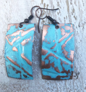 Turquoise colored rectangle form-folded copper earring