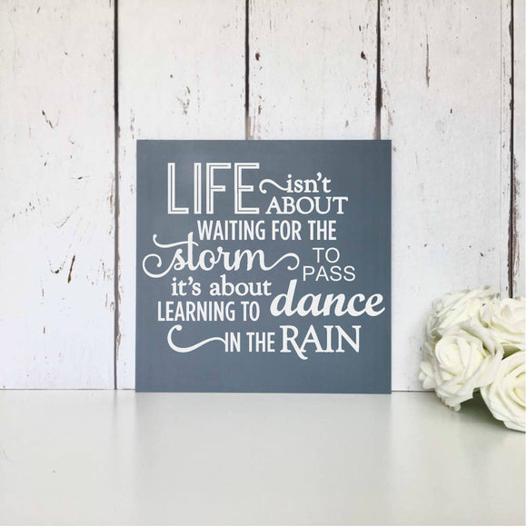 Life isn't about waiting for the storm to pass, it's about learning to dance in the rain • Motivational Sign • Inspirational Quote