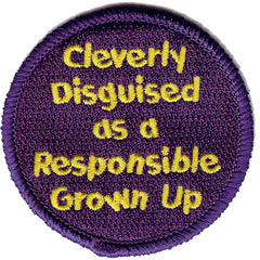 Embroidered circular badge with the words 'Cleverly Disguised as a Responsible Grown Up'