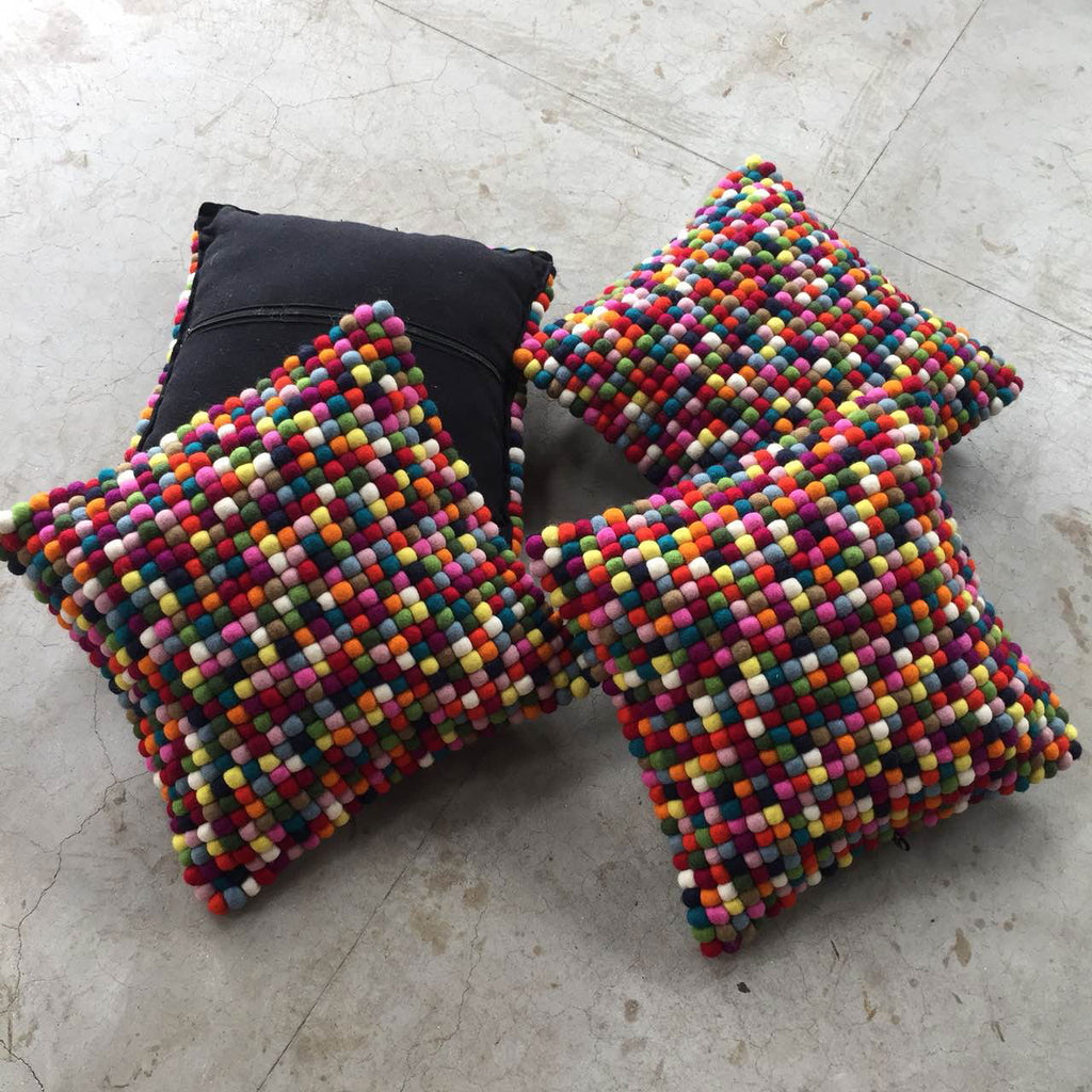 multicolored felt ball cushion