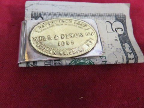 "Money Clip: ""Will & Finck Co., Patent Faro Lamp"""