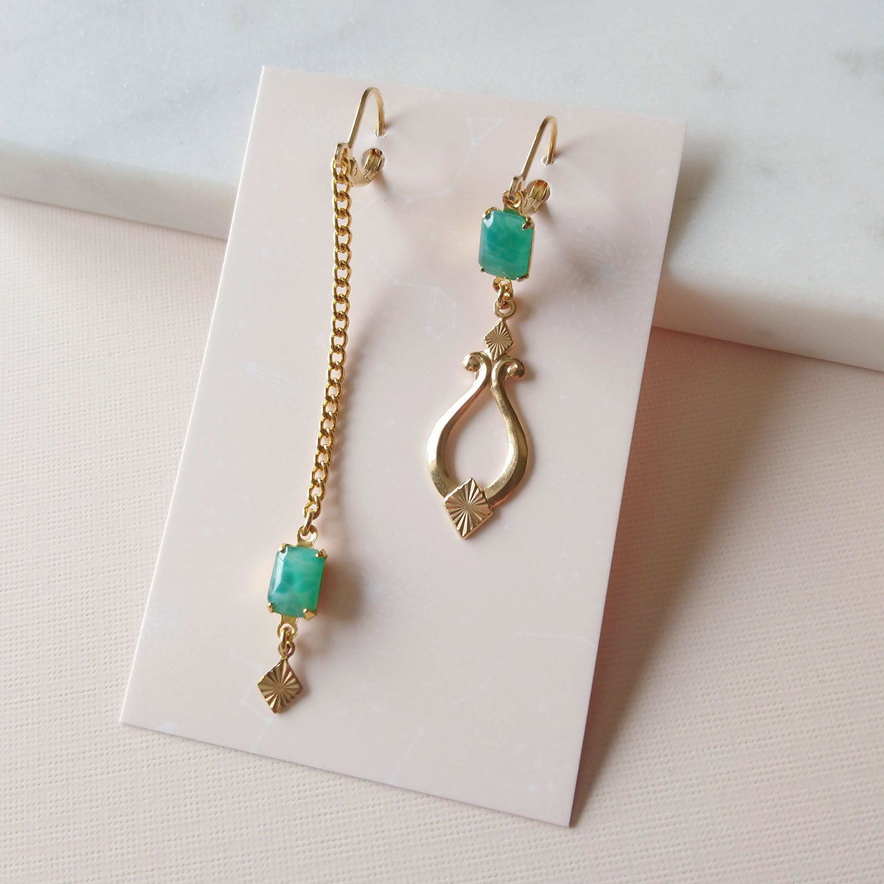 Asymmetrical earrings jade green