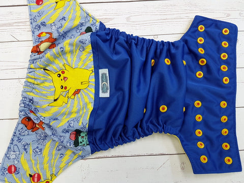 Red Cheeks (royal pul, citron awj, two toned snaps; red caps, marigold pieces) <br>Wrap Around, One Size Pocket Diaper<br>Instock and Ready to Ship