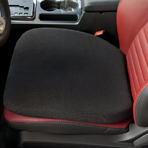 A close up image of a gel seat cushion on a leather car seat