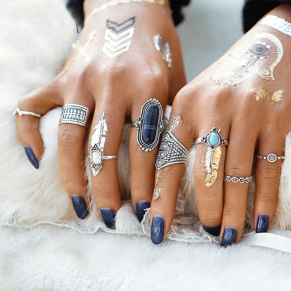 multiple silver ring set on woman's hands