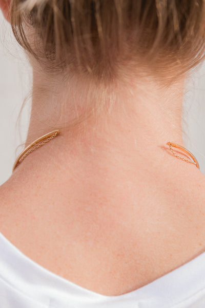 gold open collar choker with tassel