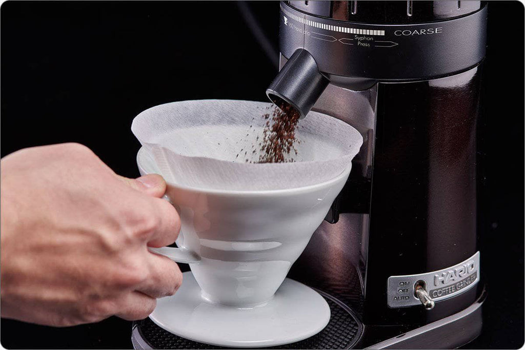 Hario V60 Electric Coffee Grinder grinding into ceramic dripper