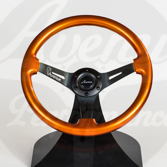 AVENUE STEERING WHEEL BURNT ORANGE/ BLACK SPOKES