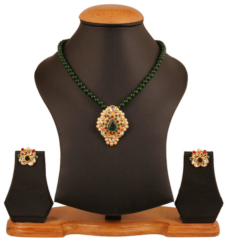 Touchstone golden plated Indian bollywood Kundan look red green color jewelry pendant set for women