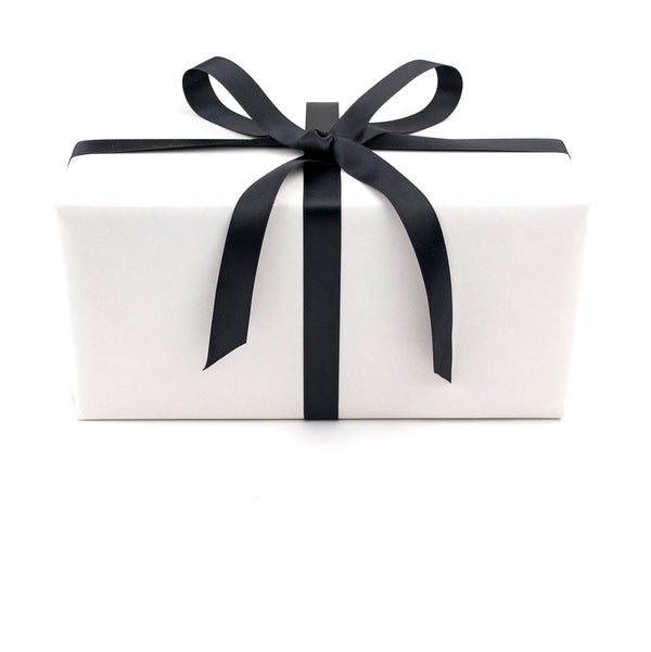 White gift wrapped box of Pinckney Cookie Cafe cookies