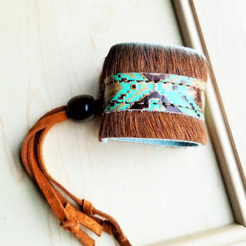 A women's leather cuff bracelet from The Jewelry Junkie.