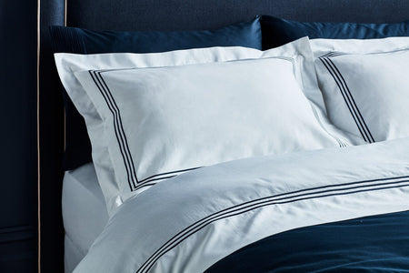 australian designed luxury organic cotton hotel collection quilt set in white with navy stitching